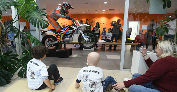Jumping an e-motorbike in the hall of Trento Proton Therapy Center
